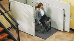Disabled woman riding down a commercial wheelchair lift