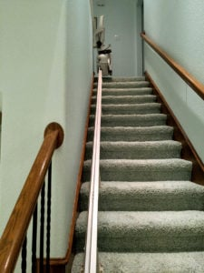 A Bruno Elan stair lift installed by Accessible Systems on a straight staircase in this Dallas, Texas home