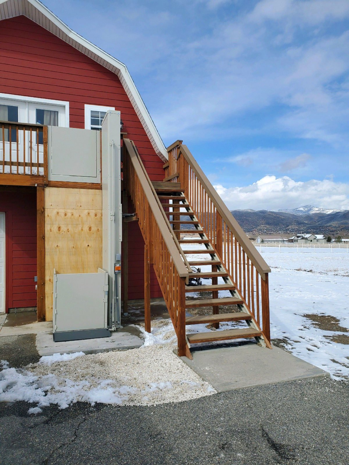 Wheelchair lift to second floor, level apartment over a barn-shaped garage installed for a handicap father in Salida, CO